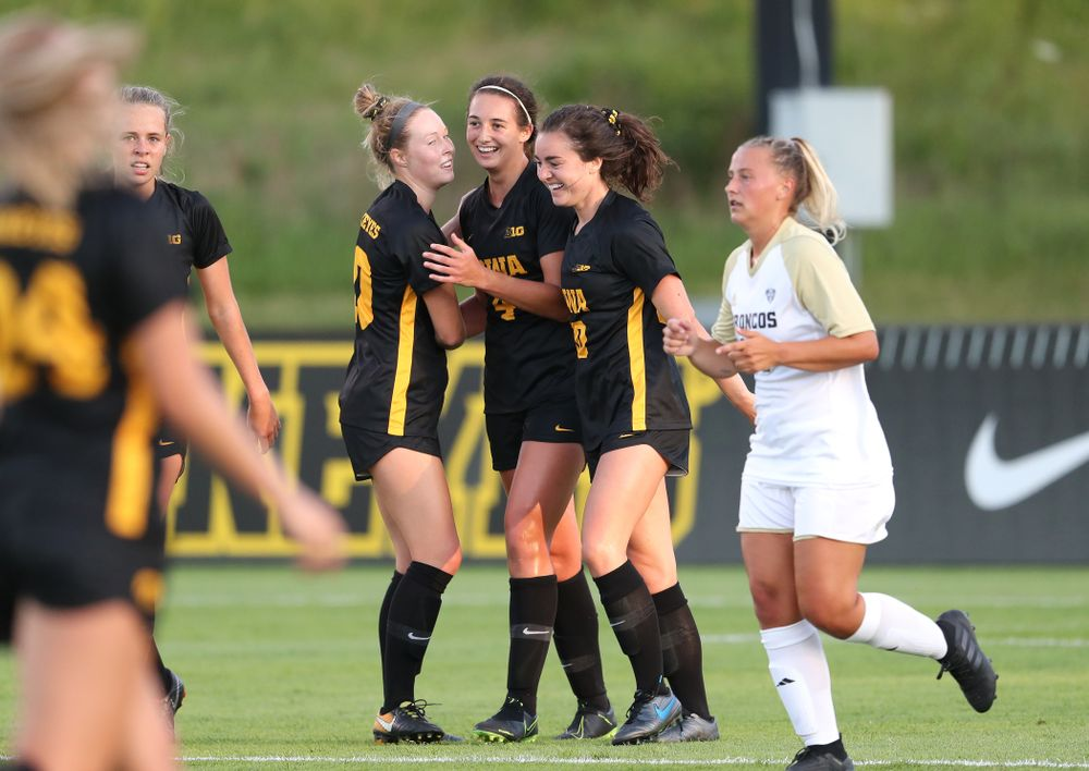Iowa Hawkeyes forward Kaleigh Haus (4) and midfielder/defender Natalie Winters (10) celebrate a goal against Western Michigan Thursday, August 22, 2019 at the Iowa Soccer Complex. (Brian Ray/hawkeyesports.com)