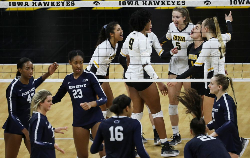 Iowa Hawkeyes setter Brie Orr (7), Iowa Hawkeyes outside hitter Meghan Buzzerio (5) and Iowa Hawkeyes defensive specialist Molly Kelly (1) celebrate after winning a point during a match against Penn State at Carver-Hawkeye Arena on November 3, 2018. (Tork Mason/hawkeyesports.com)