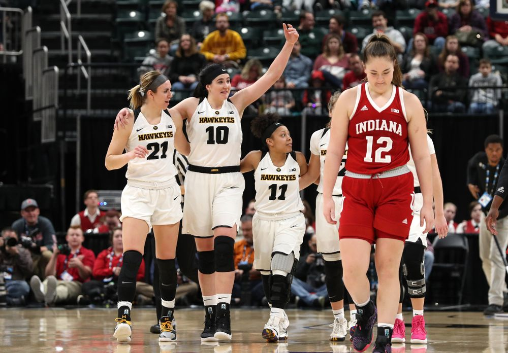 Iowa Hawkeyes forward Hannah Stewart (21), forward Megan Gustafson (10), and guard Tania Davis (11) against the Indiana Hoosiers in the quarterfinals of the Big Ten Tournament Friday, March 8, 2019 at Bankers Life Fieldhouse in Indianapolis, Ind. (Brian Ray/hawkeyesports.com)