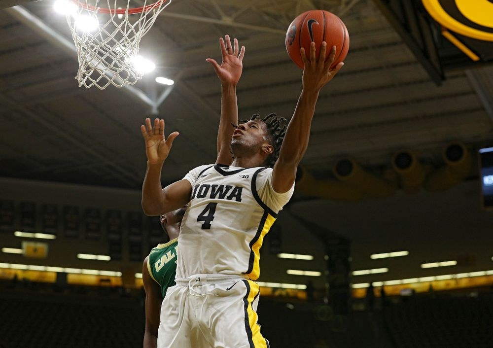 Iowa Hawkeyes guard Bakari Evelyn (4) scores a basket during the second half of their game at Carver-Hawkeye Arena in Iowa City on Sunday, Nov 24, 2019. (Stephen Mally/hawkeyesports.com)