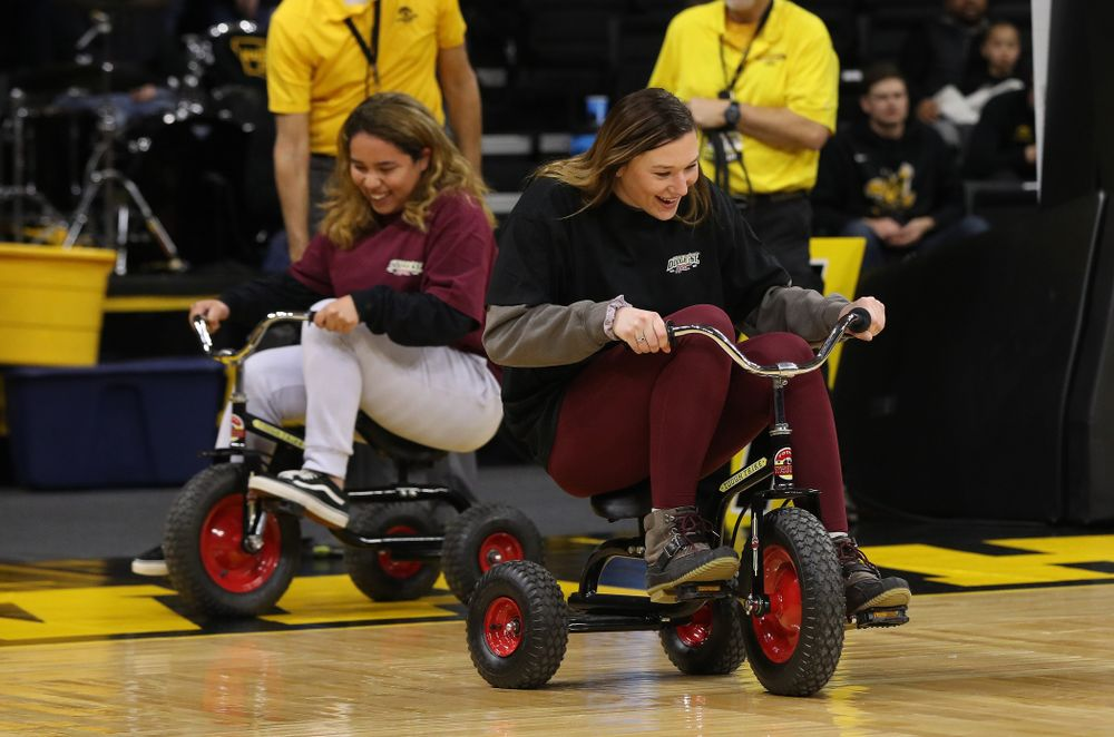 Fans race tricycles on the court during the Iowa Hawkeyes game against the Rutgers Scarlet Knights Wednesday, January 23, 2019 at Carver-Hawkeye Arena. (Brian Ray/hawkeyesports.com)