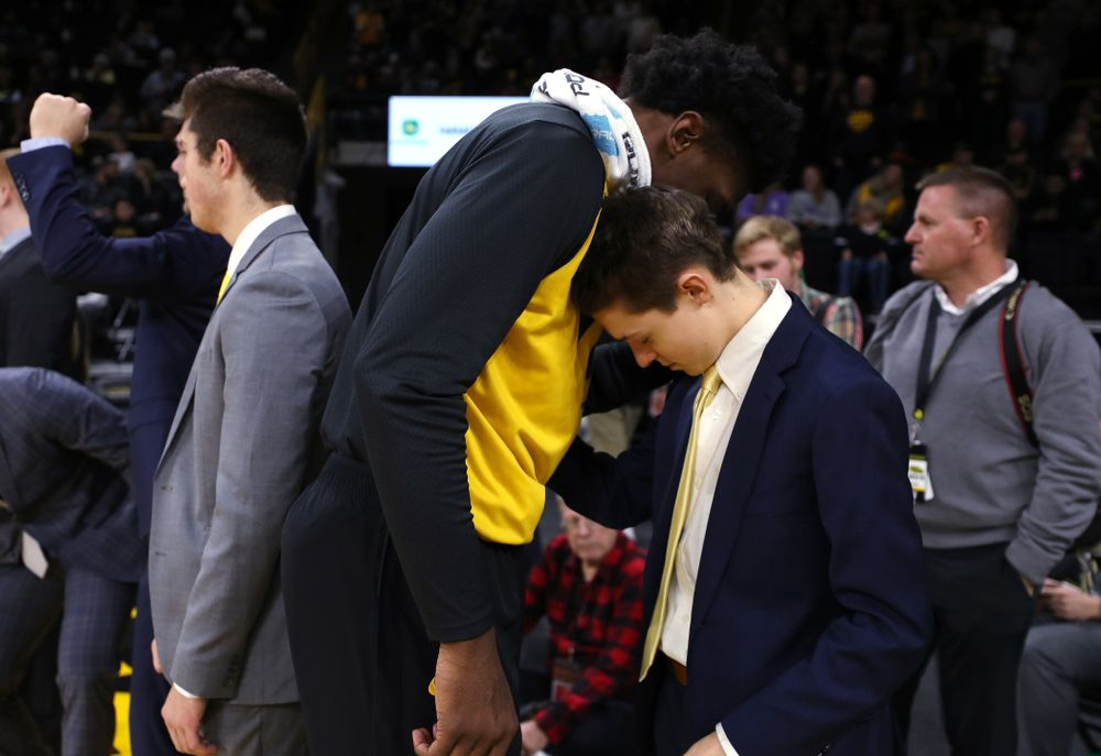 Iowa Hawkeyes forward Tyler Cook (25) prays with manager Dylan Mihalke before their game against the Nebraska Cornhuskers Sunday, January 6, 2019 at Carver-Hawkeye Arena. (Brian Ray/hawkeyesports.com)