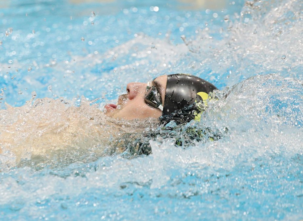 Iowa's Weston Credit swims the backstroke section of the 100-yard individual medley event during their meet against Michigan State at the Campus Recreation and Wellness Center in Iowa City on Thursday, Oct 3, 2019. (Stephen Mally/hawkeyesports.com)