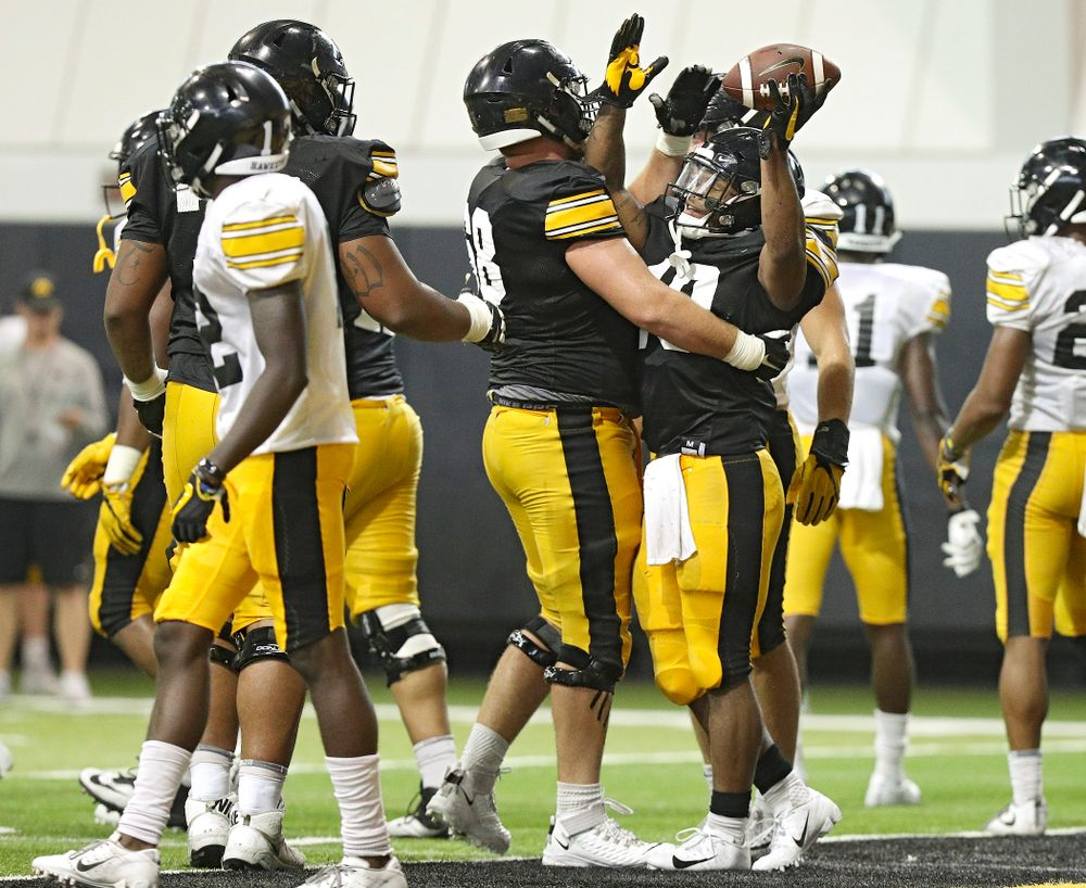 Iowa Hawkeyes running back Mekhi Sargent (10) celebrates with offensive lineman Landan Paulsen (68) in the end zone during Fall Camp Practice No. 6 at the Hansen Football Performance Center in Iowa City on Thursday, Aug 8, 2019. (Stephen Mally/hawkeyesports.com)