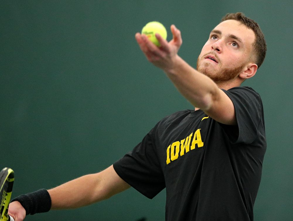 Iowa's Kareem Allaf serves during his singles match at the Hawkeye Tennis and Recreation Complex in Iowa City on Friday, February 14, 2020. (Stephen Mally/hawkeyesports.com)