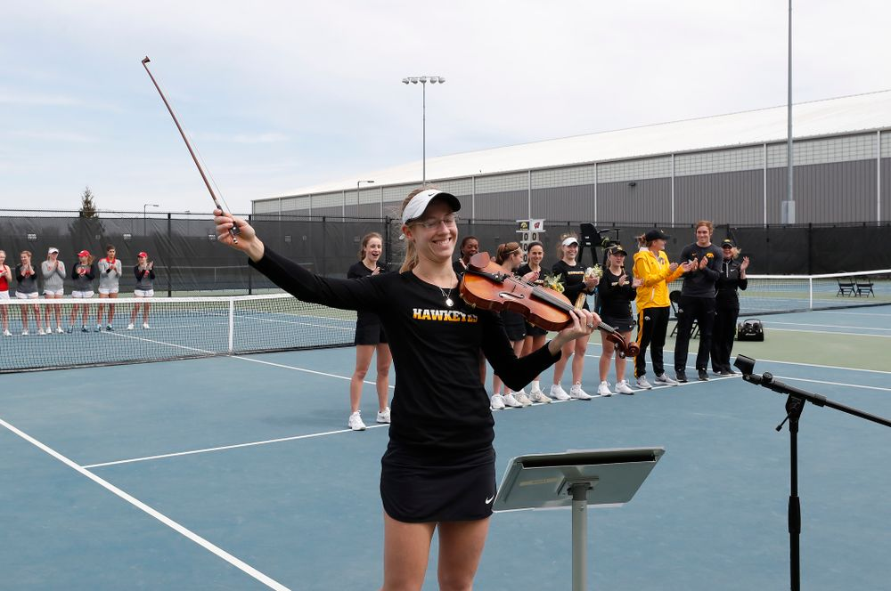 Iowa senior Montana Crawford plays the National Anthem before their match against the Wisconsin Badgers Sunday, April 22, 2018 at the Hawkeye Tennis and Recreation Center. (Brian Ray/hawkeyesports.com)