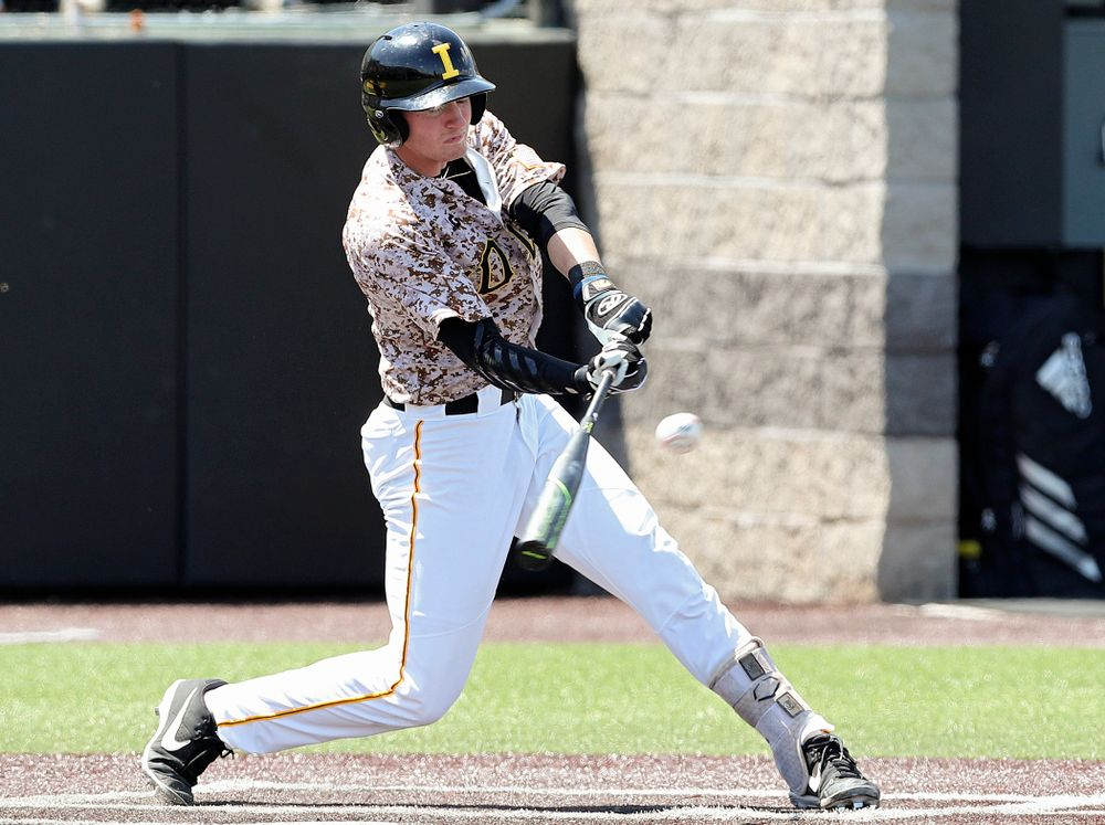 Iowa Hawkeyes second baseman Brendan Sher (2) drives a pitch for a hit during the second inning of their game against UC Irvine at Duane Banks Field in Iowa City on Sunday, May. 5, 2019. (Stephen Mally/hawkeyesports.com)