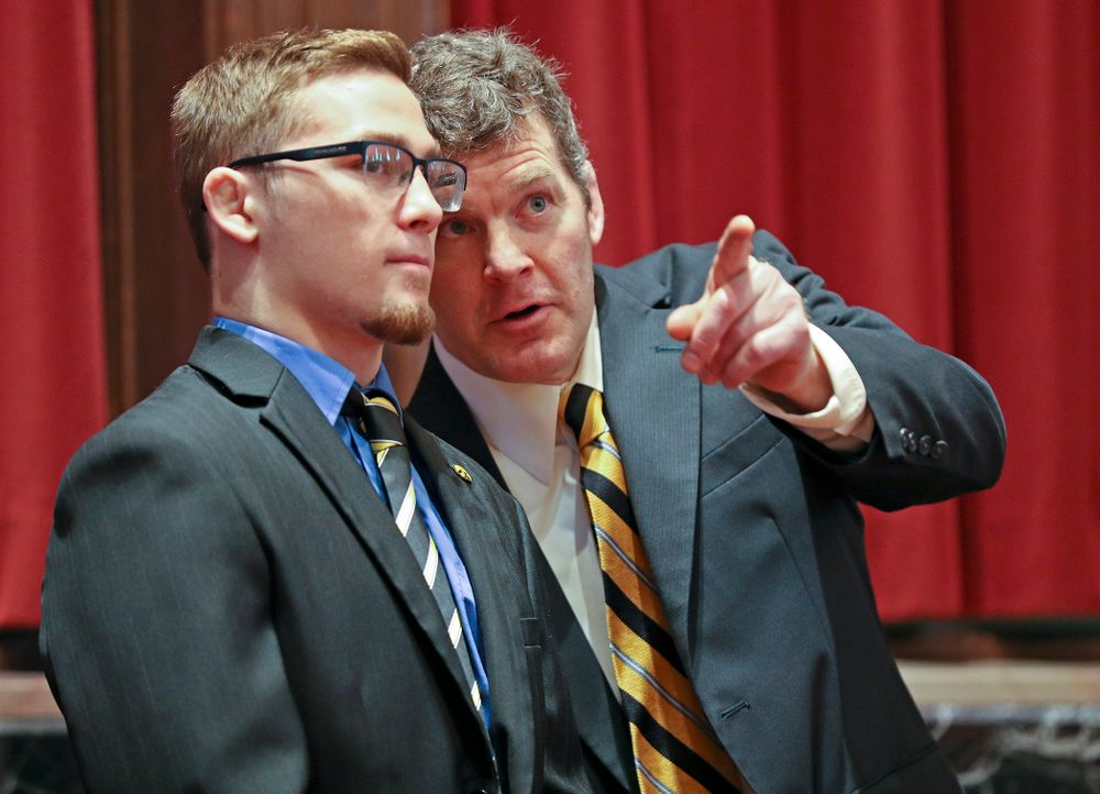 Iowa head coach Tom Brands (right) talks with Spencer Lee in the Senate Chamber at the Iowa State Capitol Building on Tuesday, Apr. 9, 2019. (Stephen Mally/hawkeyesports.com)