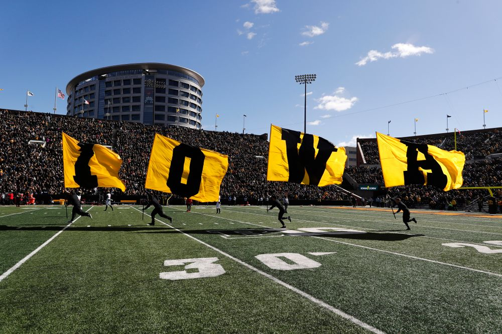 The Iowa Spirit Squad brings out the IOWA flags against the Maryland Terrapins Saturday, October 20, 2018 at Kinnick Stadium (Brian Ray/hawkeyesports.com)
