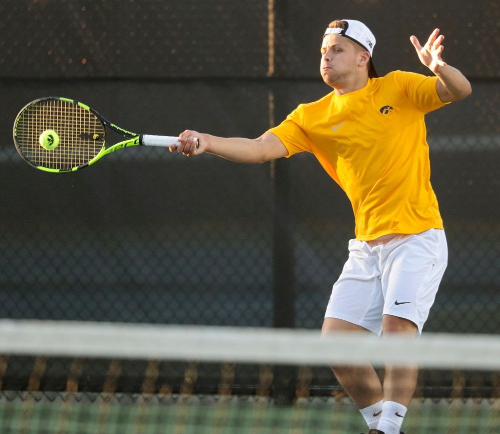 Iowa's Will Davies during his match again Michigan State at the Hawkeye Tennis and Recreation Complex in Iowa City on Friday, Apr. 19, 2019. (Stephen Mally/hawkeyesports.com)