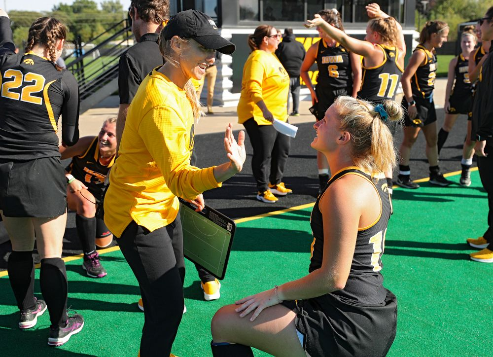 Iowa assistant coach Roz Ellis (from left) talks with Katie Birch (11) after defeating Rutgers in their match at Grant Field in Iowa City on Friday, Oct 4, 2019. (Stephen Mally/hawkeyesports.com)