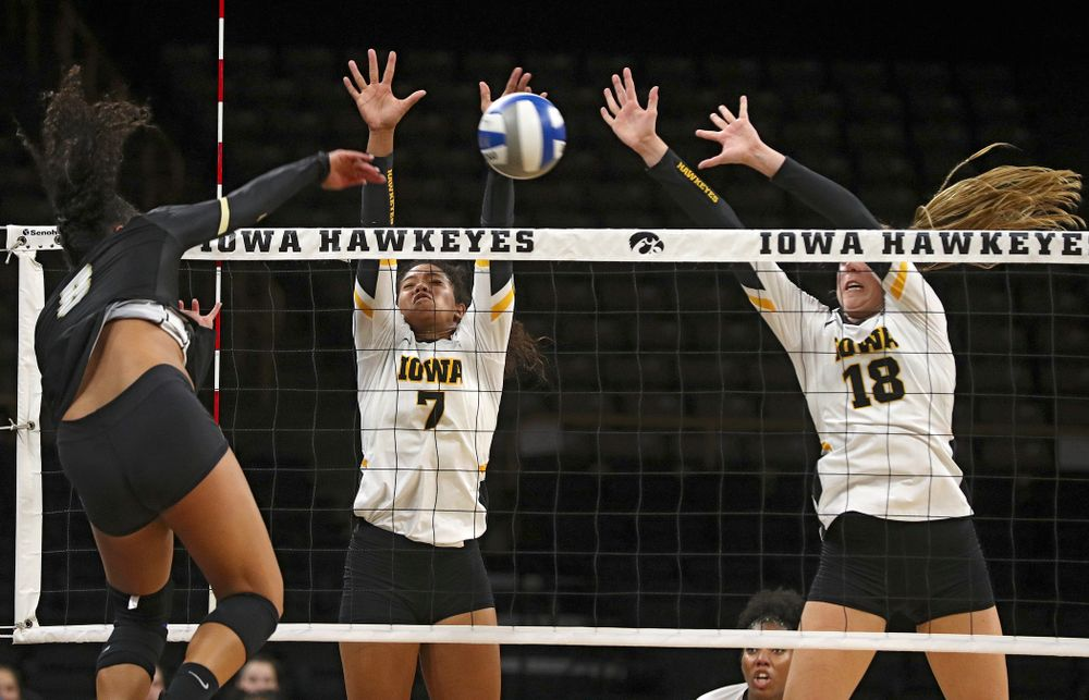 Iowa's Brie Orr (7) and Hannah Clayton (18) try for a block during the third set of their Big Ten/Pac-12 Challenge match against Colorado at Carver-Hawkeye Arena in Iowa City on Friday, Sep 6, 2019. (Stephen Mally/hawkeyesports.com)