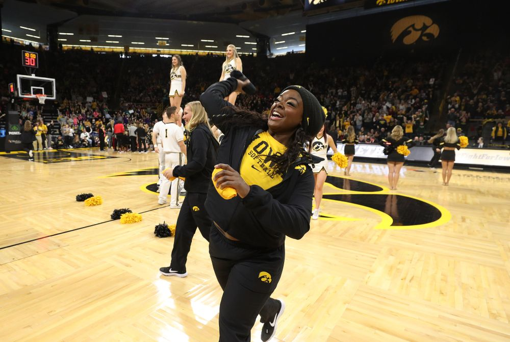 The Iowa Softball team throws out t-shirts during the Iowa Hawkeyes game against the Purdue Boilermakers Sunday, January 27, 2019 at Carver-Hawkeye Arena. (Brian Ray/hawkeyesports.com)