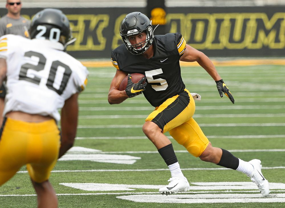 Iowa Hawkeyes wide receiver Oliver Martin (5) runs after pulling in a pass during Fall Camp Practice No. 8 at Kids Day at Kinnick Stadium in Iowa City on Saturday, Aug 10, 2019. (Stephen Mally/hawkeyesports.com)