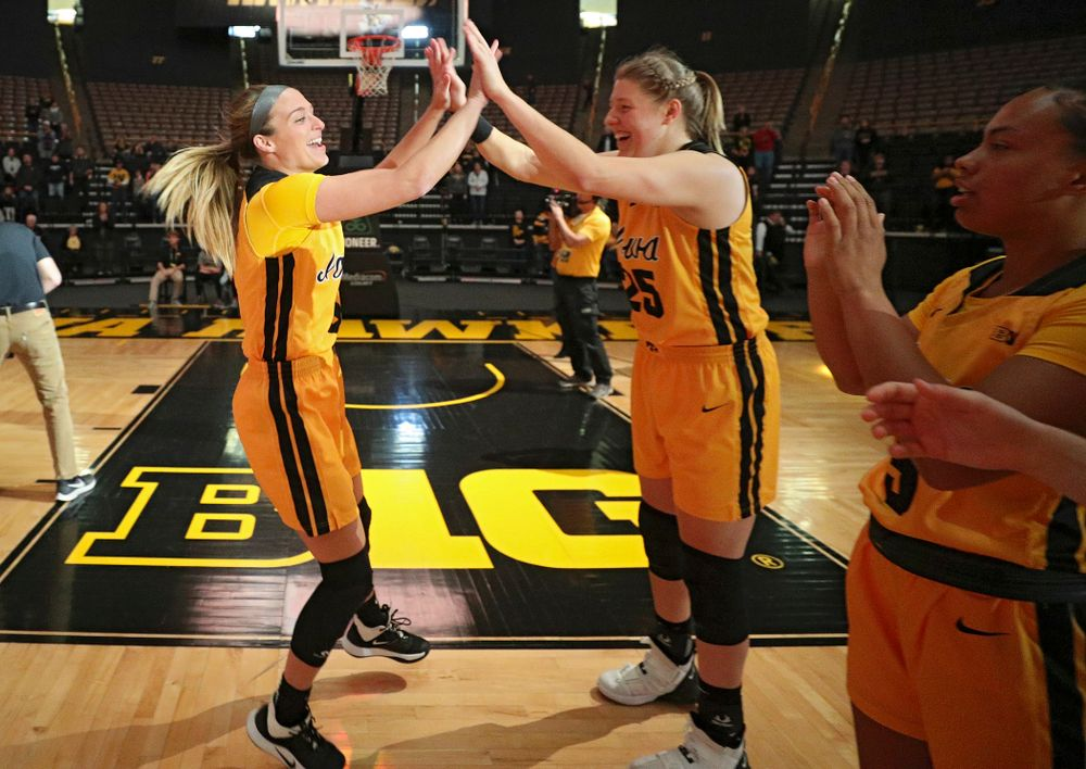 Iowa guard Makenzie Meyer (3) gets a high-five from forward/center Monika Czinano (25) as she is introduced before their game against Winona State at Carver-Hawkeye Arena in Iowa City on Sunday, Nov 3, 2019. (Stephen Mally/hawkeyesports.com)