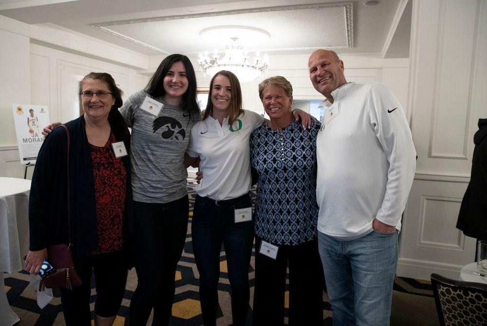 Iowa Hawkeyes forward Megan Gustafson (10), OregonÕs Sabrina Ionescu, and WNBA Legend Ann Meyers Drysdale  during the Wooden Award DukeÕs Dinner Thursday, April 11, 2019 at the LA Athletic Club. (Brian Ray/hawkeyesports.com)
