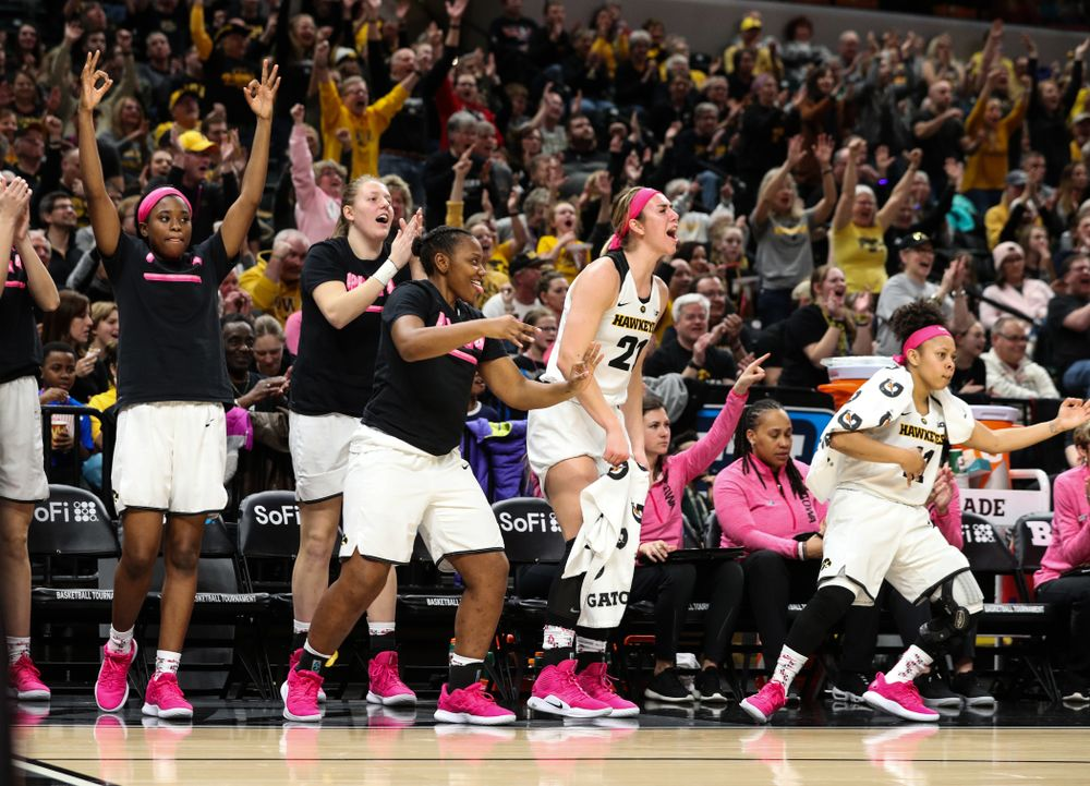 The Iowa Hawkeyes celebrate a three point basket by guard Kathleen Doyle (22) against the Rutgers Scarlet Knights in the semi-finals of the Big Ten Tournament Saturday, March 9, 2019 at Bankers Life Fieldhouse in Indianapolis, Ind. (Brian Ray/hawkeyesports.com)