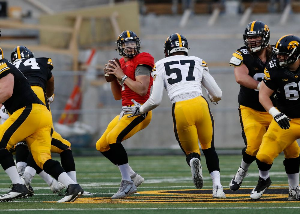 Iowa Hawkeyes quarterback Nathan Stanley (4) and defensive end Chauncey Golston (57) during the final spring practice Friday, April 20, 2018 at Kinnick Stadium. (Brian Ray/hawkeyesports.com)