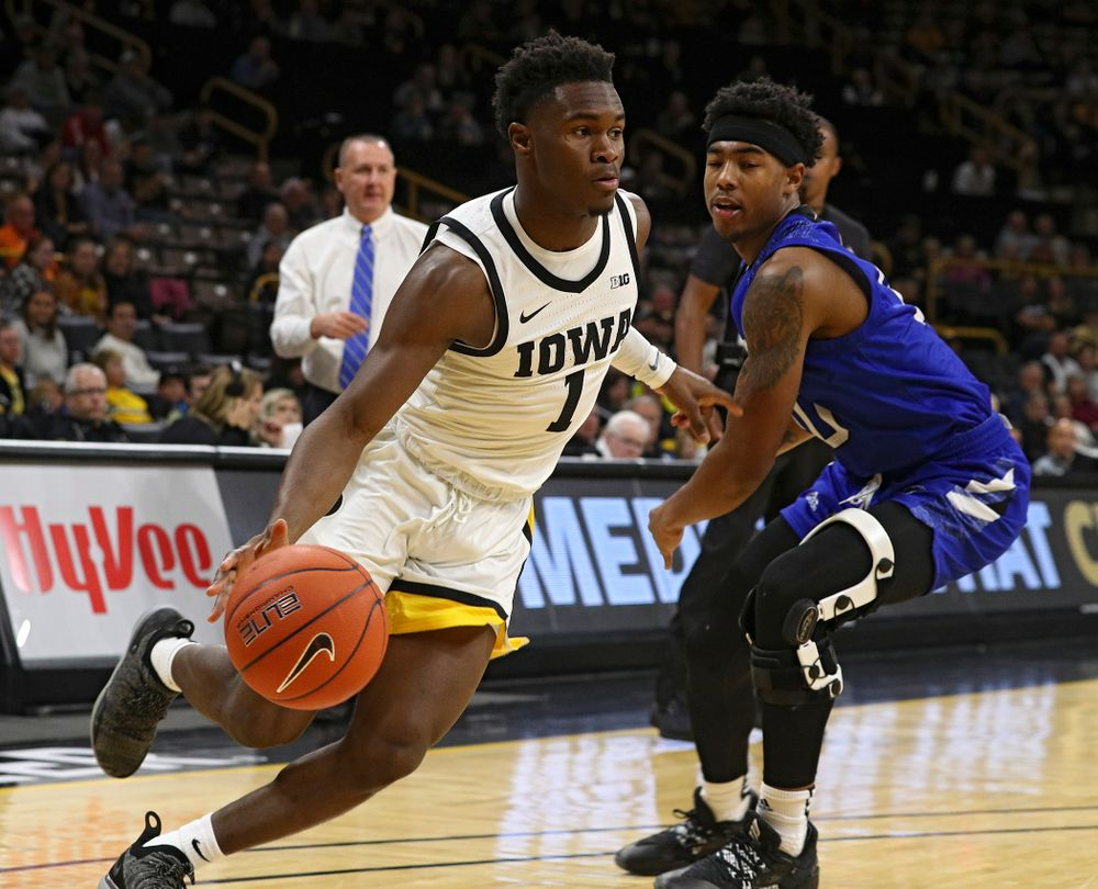 Iowa Hawkeyes guard Joe Toussaint (1) drives in with the ball during the first half of their exhibition game against Lindsey Wilson College at Carver-Hawkeye Arena in Iowa City on Monday, Nov 4, 2019. (Stephen Mally/hawkeyesports.com)