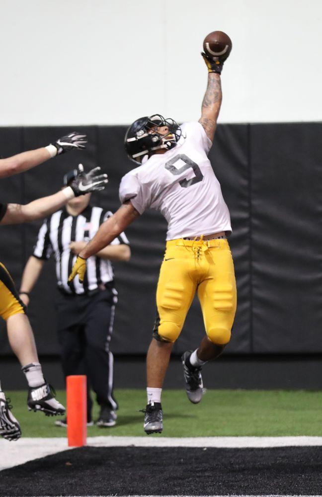 Iowa Hawkeyes defensive back Geno Stone (9)