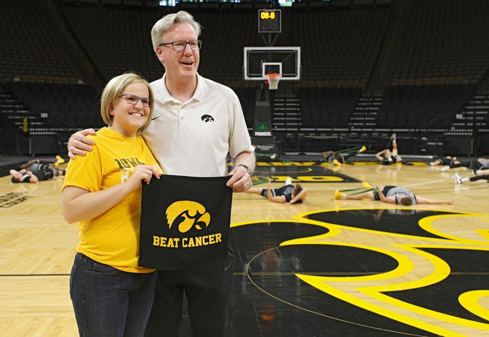 Iowa Hawkeyes head coach Fran McCaffery takes pictures with visitors from the University of Iowa Hospitals and Clinics Adolescent and Young Adult (AYA) Cancer Program after practice at Carver-Hawkeye Arena in Iowa City on Monday, Sep 30, 2019. (Stephen Mally/hawkeyesports.com)