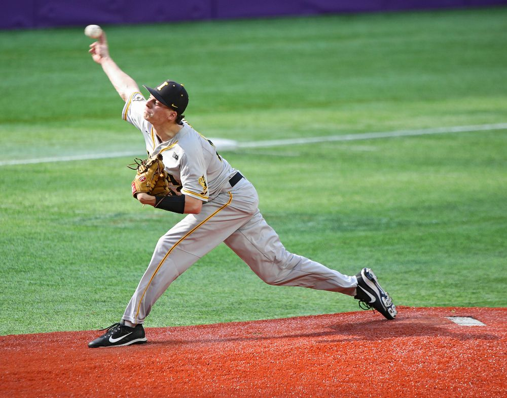 Iowa Hawkeyes pitcher Drew Irvine (12) delivers to the plate during the seventh inning of their CambriaCollegeClassic game at U.S. Bank Stadium in Minneapolis, Minn. on Friday, February 28, 2020. (Stephen Mally/hawkeyesports.com)