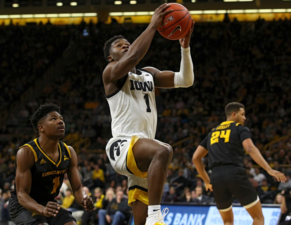 Iowa Hawkeyes guard Joe Toussaint (1) scores a basket during the first half of their their game at Carver-Hawkeye Arena in Iowa City on Sunday, December 29, 2019. (Stephen Mally/hawkeyesports.com)