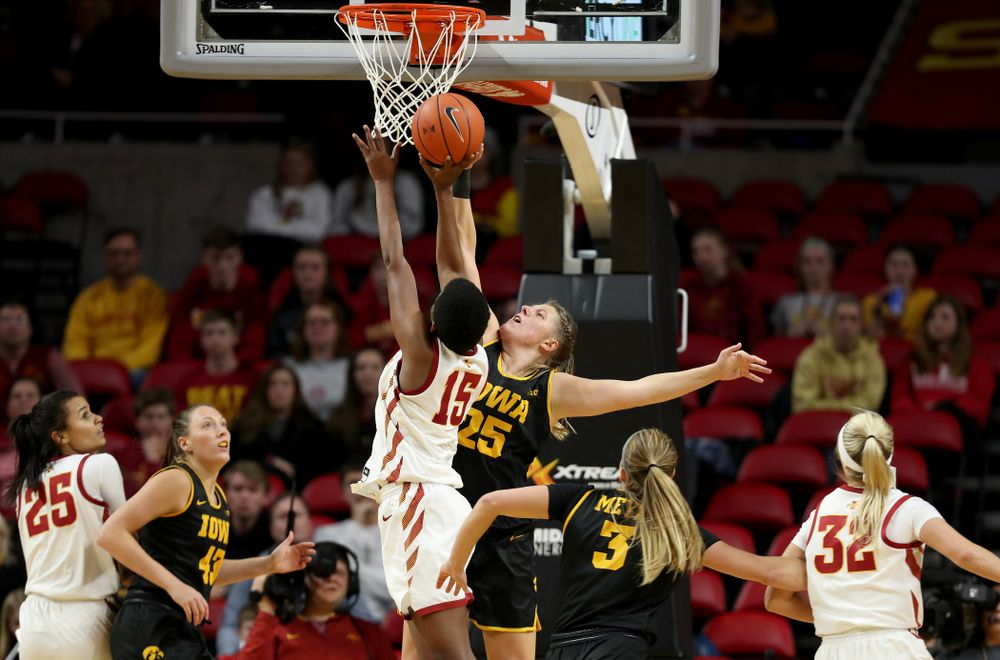 Iowa Hawkeyes forward/center Monika Czinano (25) blocks a shot against the Iowa State Cyclones Wednesday, December 11, 2019 at Hilton Coliseum in Ames, Iowa(Brian Ray/hawkeyesports.com)