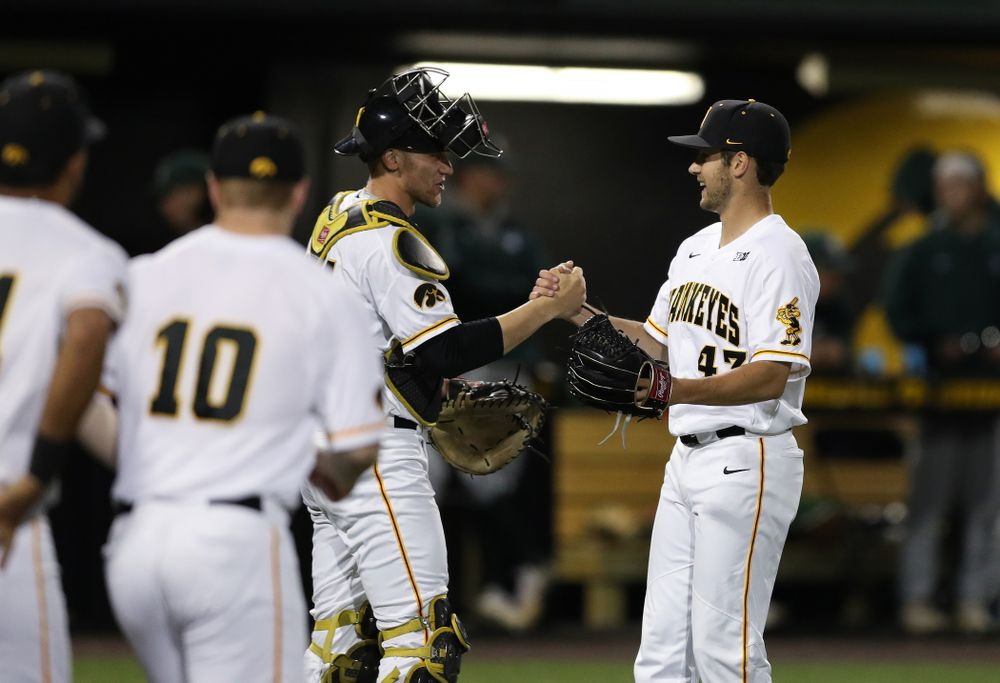 Iowa Hawkeyes Grant Leonard (43) and catcher Austin Martin (34) against the Michigan State Spartans Friday, May 10, 2019 at Duane Banks Field. (Brian Ray/hawkeyesports.com)
