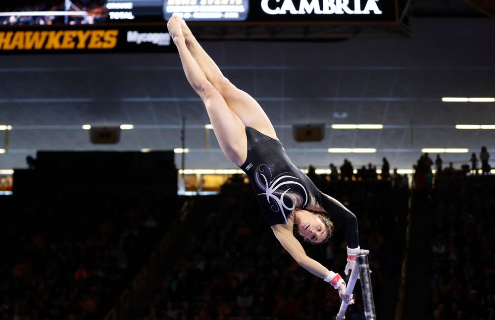 Iowa's Lanie Snyder competes on the bars against the Nebraska Cornhuskers