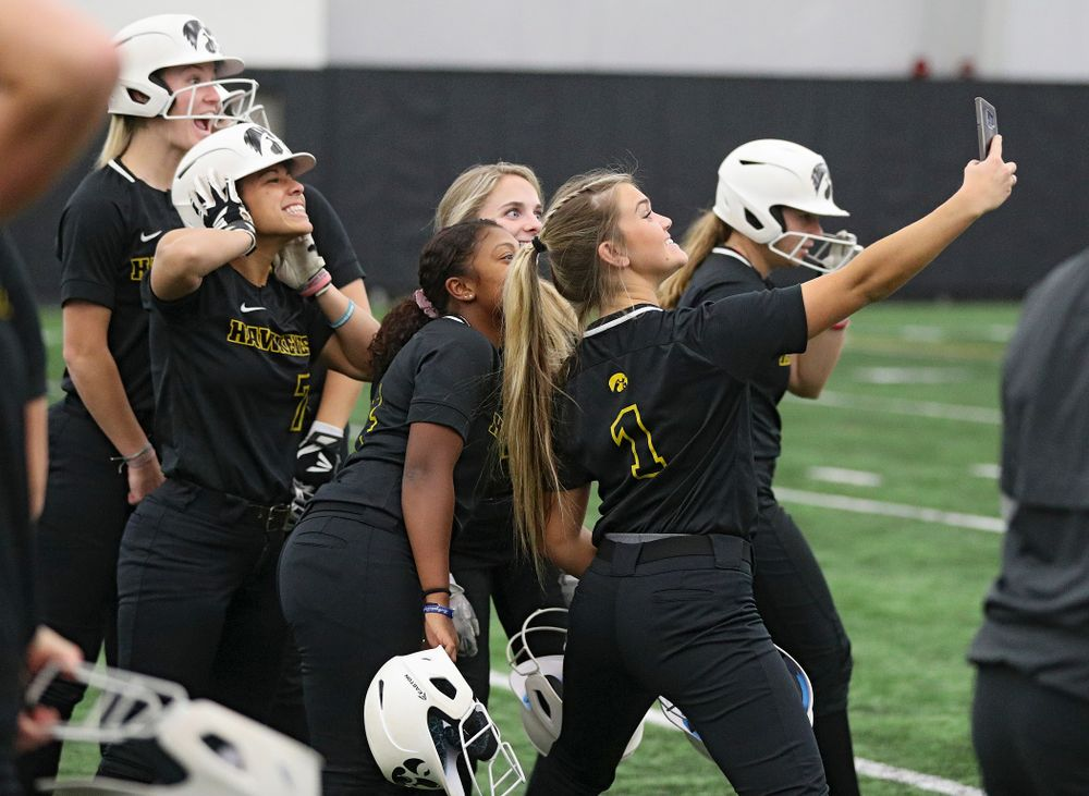 Iowa infielder Cameron Cecil (1) takes a selfie with her teammates during Iowa Softball Media Day at the Hawkeye Tennis and Recreation Complex in Iowa City on Thursday, January 30, 2020. (Stephen Mally/hawkeyesports.com)