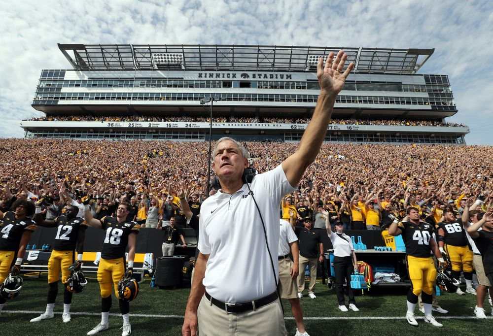 Iowa Hawkeyes head coach Kirk Ferentz waves to the Stead Family ChildrenÕs Hospital at the end of the first quarter of their game against the Rutgers Scarlet Knights Saturday, September 7, 2019 at Kinnick Stadium. (Brian Ray/hawkeyesports.com)