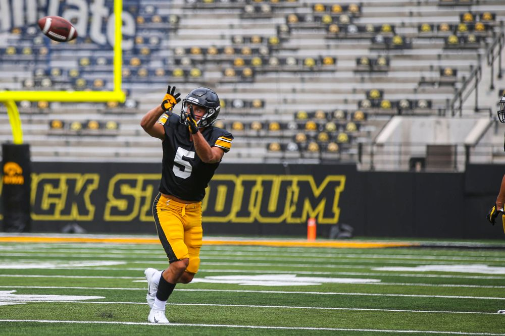 Iowa's Oliver Martin catches a pass during the Kids Day at Kinnick Stadium on Saturday, August 10, 2019  (Lily Smith/hawkeyesports.com)