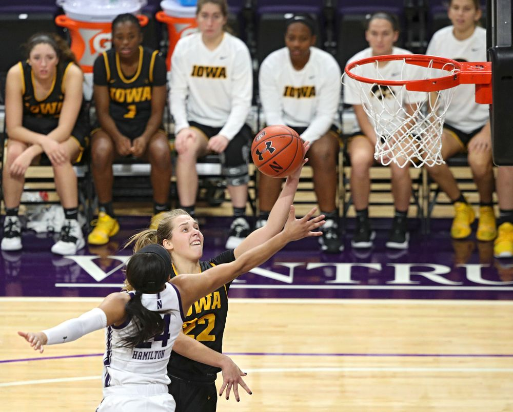 Iowa Hawkeyes guard Kathleen Doyle (22) makes a basket during the fourth quarter of their game at Welsh-Ryan Arena in Evanston, Ill. on Sunday, January 5, 2020. (Stephen Mally/hawkeyesports.com)