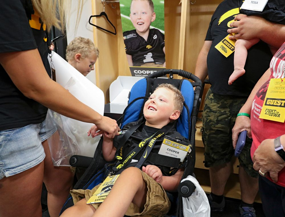 Kid Captain Cooper Leeman at his locker during Kids Day at Kinnick Stadium in Iowa City on Saturday, Aug 10, 2019. (Stephen Mally/hawkeyesports.com)