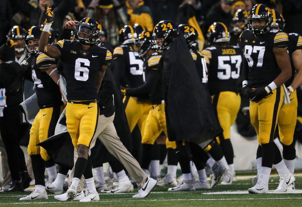 Iowa Hawkeyes wide receiver Ihmir Smith-Marsette (6) signals for a first down after a replay review reversed the call on the field during a game against Northwestern at Kinnick Stadium on November 10, 2018. (Tork Mason/hawkeyesports.com)