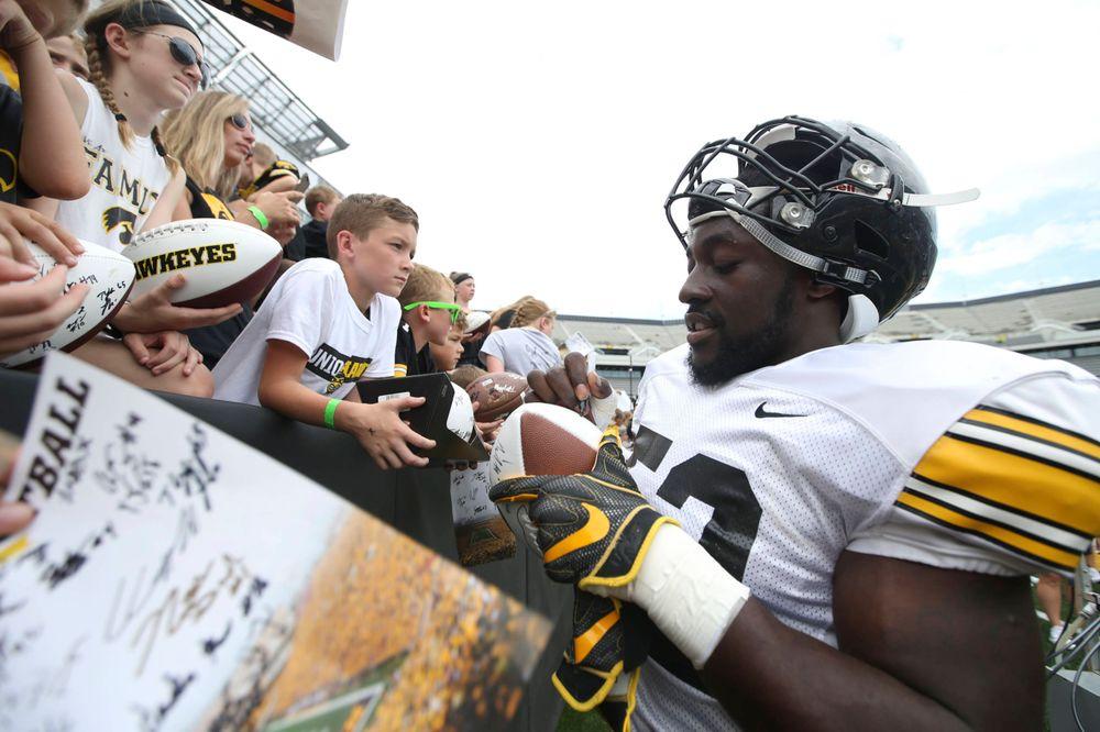 Iowa Hawkeyes linebacker Amani Jones (52) signs autographs during Kids Day at Kinnick Stadium on Saturday, August 10, 2019. (Lily Smith/hawkeyesports.com)
