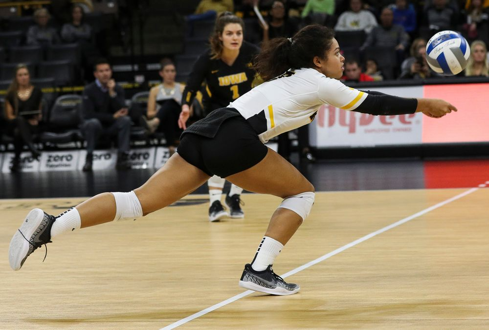 Iowa Hawkeyes setter Brie Orr (7) digs the ball during a match against Maryland at Carver-Hawkeye Arena on November 23, 2018. (Tork Mason/hawkeyesports.com)