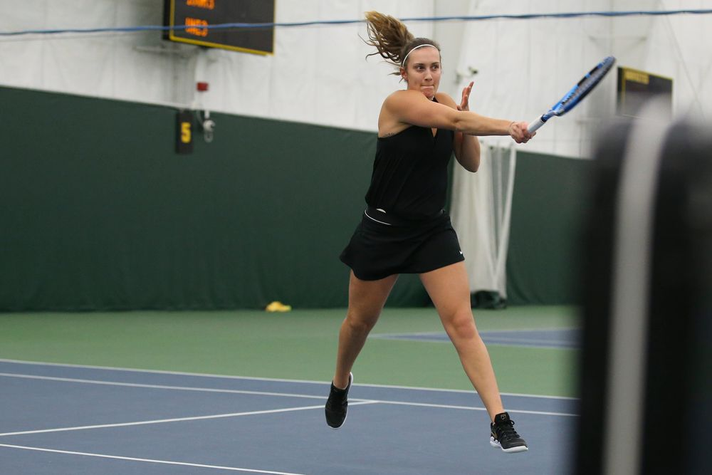 Iowa's Ashleigh Jacobs returns a ball during the Iowa women's tennis meet vs UNI  on Saturday, February 29, 2020 at the Hawkeye Tennis and Recreation Complex. (Lily Smith/hawkeyesports.com)