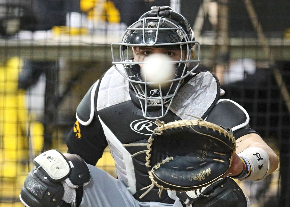Iowa Hawkeyes catcher Brett McCleary (32) looks in a pitch during practice at the Hansen Football Performance Center in Iowa City on Friday, January 24, 2020. (Stephen Mally/hawkeyesports.com)