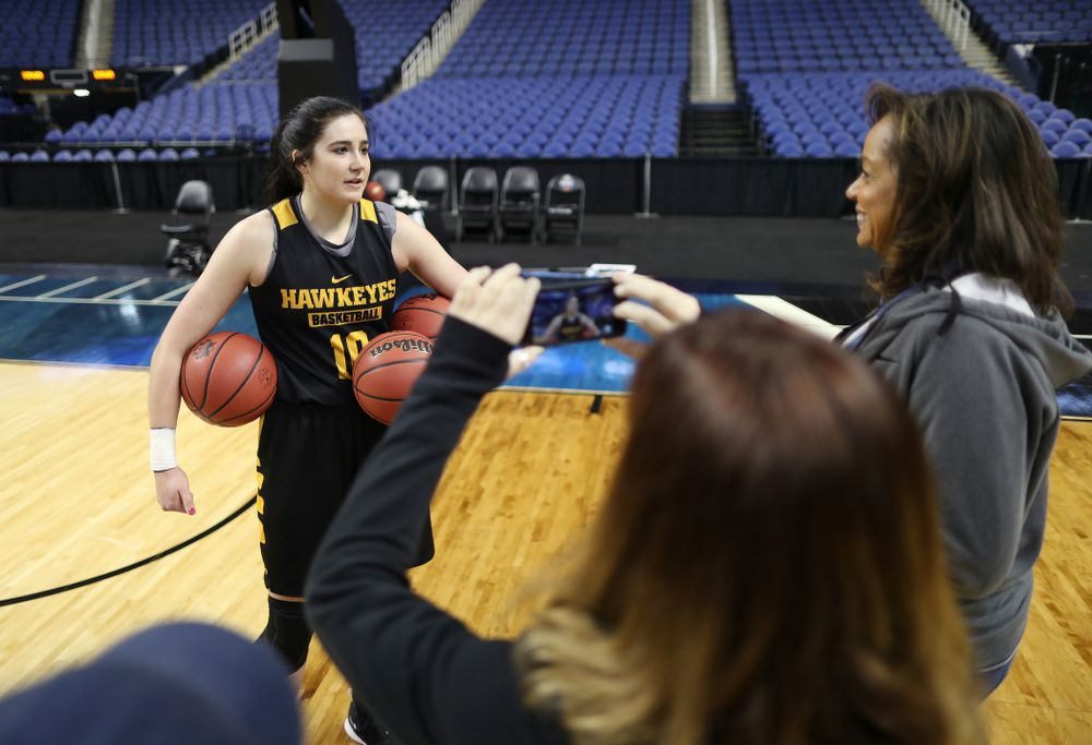 Iowa Hawkeyes forward Megan Gustafson (10) talks with the ESPN Crew following practice for their Sweet 16 matchup against NC State Friday, March 29, 2019 at the Greensboro Coliseum in Greensboro, NC.(Brian Ray/hawkeyesports.com)