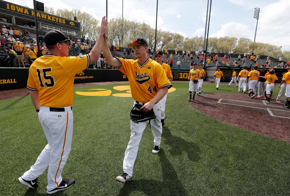 Iowa Hawkeyes outfielder Robert Neustrom (44) and associate head coach Marty Sutherland against the Oklahoma State Cowboys Sunday, May 6, 2018 at Duane Banks Field. (Brian Ray/hawkeyesports.com)