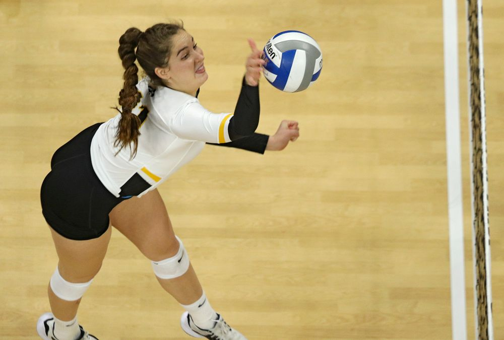 Iowa's Blythe Rients (11) sends the ball over during the third set of their match at Carver-Hawkeye Arena in Iowa City on Saturday, Nov 30, 2019. (Stephen Mally/hawkeyesports.com)
