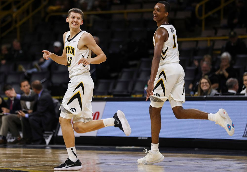 Iowa Hawkeyes guard Austin Ash (13) reacts after making a 3-pointer during a game against Guilford College at Carver-Hawkeye Arena on November 4, 2018. (Tork Mason/hawkeyesports.com)