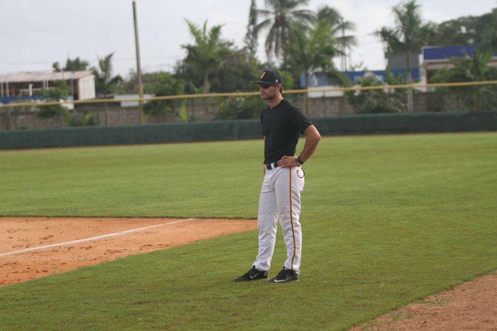 Corbin Woods -- 1st base coach extraordinaire Iowa vs. Paulino Academy Nov. 24, 2016 Photo: James Allan