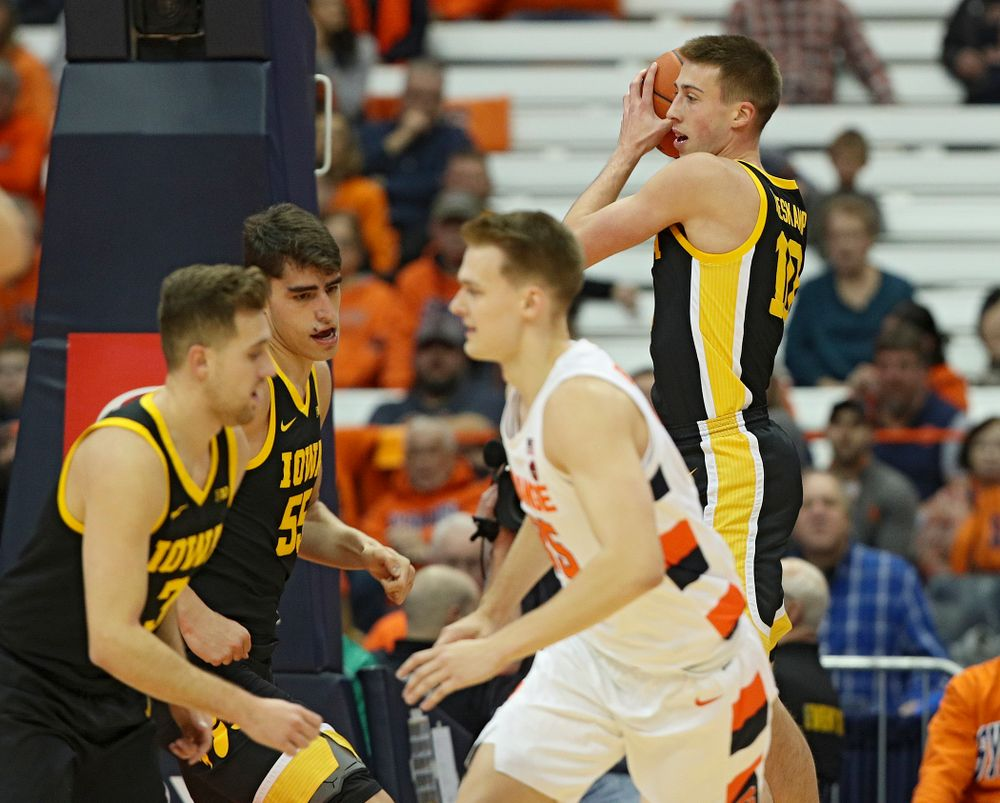 Iowa Hawkeyes guard Joe Wieskamp (10) pulls down a rebound during the first half of their ACC/Big Ten Challenge game at the Carrier Dome in Syracuse, N.Y. on Tuesday, Dec 3, 2019. (Stephen Mally/hawkeyesports.com)