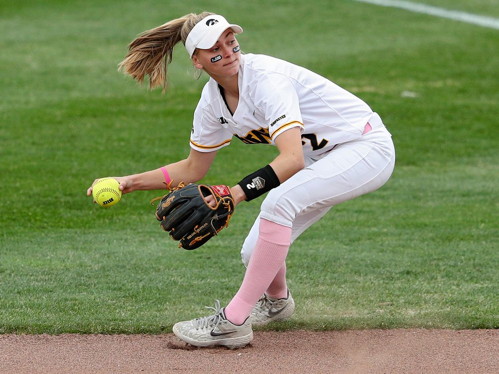 Iowa second baseman Aralee Bogar (2) fields a ball before throwing to first base for an out during the first inning of their game against Iowa State at Pearl Field in Iowa City on Tuesday, Apr. 9, 2019. (Stephen Mally/hawkeyesports.com)