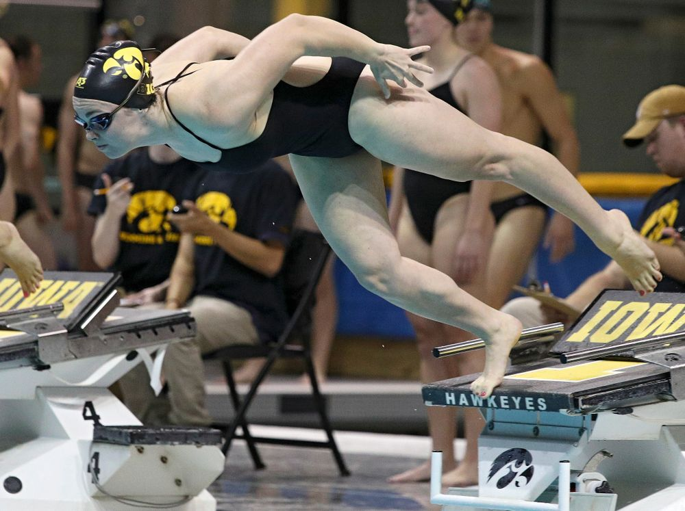Iowa's Lexi Horner takes off for the 100-yard individual medley event during their meet against Michigan State at the Campus Recreation and Wellness Center in Iowa City on Thursday, Oct 3, 2019. (Stephen Mally/hawkeyesports.com)