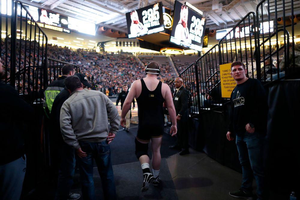 Iowa's Sam Stoll wrestles Minnesota's Rylee Streifel at heavyweight