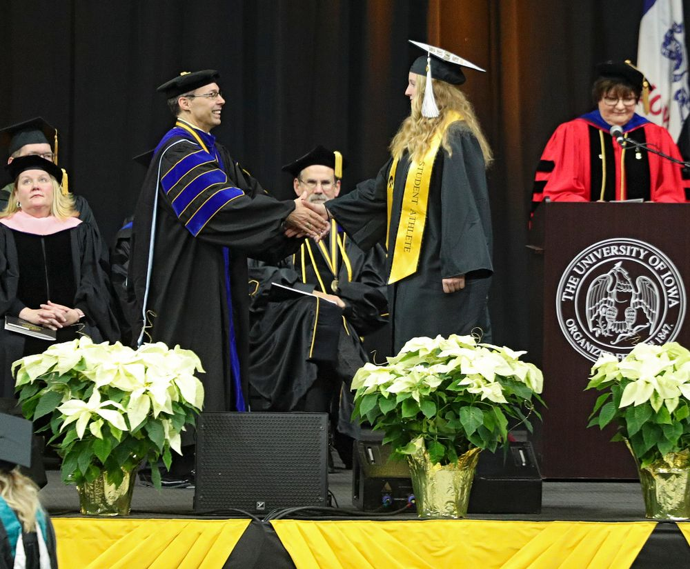 Iowa Track and Field's Allison Wahrman during the College of Liberal Arts and Sciences and University College Fall 2019 Commencement ceremony at Carver-Hawkeye Arena in Iowa City on Saturday, December 21, 2019. (Stephen Mally/hawkeyesports.com)